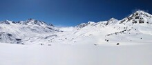 Large Mountain Panorama Picture. View Of The Fluelapss Above Davos. Beautiful Winter Landscape. Skitour Sentisch Horn