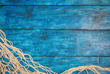 Fishing Net On Boho Blue Board Background With Copy Space