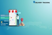Concept Of Delivery Tracking, Young Man Wear A Medical Face Mask And Standing Near A Big Screen Of Smartphone To Track And Follow Up The Shipment That Ordered By Using Application On The Phone.