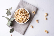 Bowl With Cashew Nuts On A White Background With Textiles, Vegetarian Healthy Food.