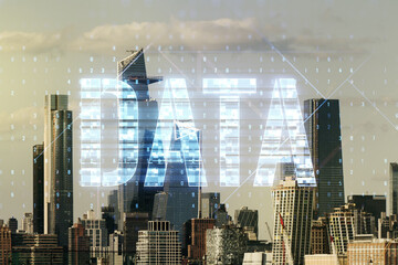 Data word hologram on New York city office buildings background, big data and blockchain concept. Multiexposure