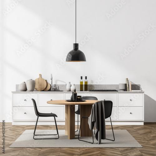 Fotografiet Light dining room interior with minimalist furniture and kitchen set