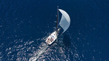 Aerial Drone Top Down Photo Of Beautiful Sail Boat With Trained Crew Cruising In Deep Blue Aegean Sea
