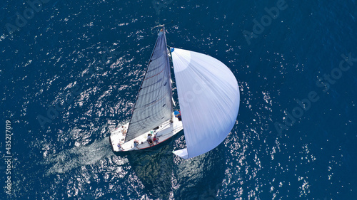 Fotografering Aerial drone top down photo of beautiful sailing boat cruising in deep blue Atla