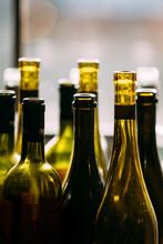 Wine Bottles In Window Light
