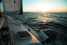 Yacht Boat In The Open Sea During Amazing Sunset. Luxury Sailing.