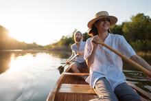 Couple Paddling Canoe On Lake, Copy Space