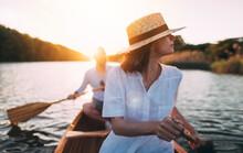 Enjoy Paddling Canoe On The Sunset Lake