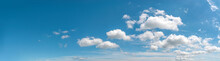 Clear Turquoise Blue Summer Sky With Few Fluffy Clouds. Seasonal Wide Banner Image For Weather, Vacations And Travel Mockup. Panoramic Azure Skyscape With Copy Space. Sky Only.