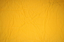 A Fragment Of Wrinkle-resistant Natural Leather Painted In A Bright Yellow Color.