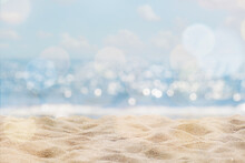 Abstract Seascape With Sand, Tropical Beach Background. Blur Bokeh Light Of Calm Sea And Sky. Summertime Vacation Background Concept.