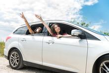 Two Female Friends Sitting Inside Car For Best Travel