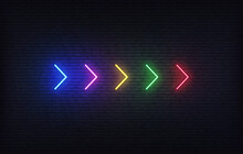 Neon Futuristic Arrow Sign. Set Of Colorful Glowing Neon Arrow Pointer On Brick Wall Background