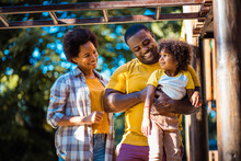 African American Family Having Fun Outdoors.