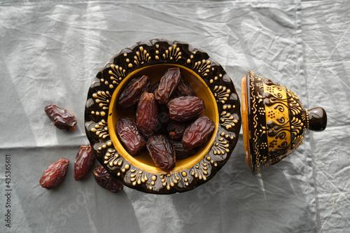 Fotografia, Obraz Delicious dates in an inlaid ceramic bowl