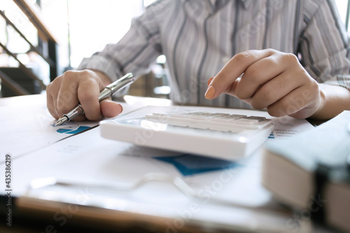 Photo Accountant or banker making calculations Bookkeeper Clerk, Bank Advisor And Auditor
