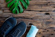 Sports Equipment - Sneakers, Water,monstera Leaf ,towel. Sport Background On Wooden Floor, Top View