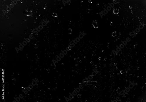 Tela water drops on black background