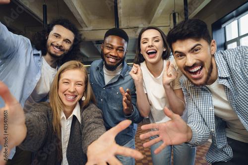 Obraz na płótnie Happy overjoyed business team celebrate corporate victory