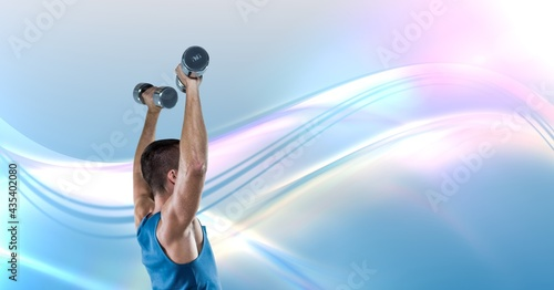 Composition of fit caucasian man exercising with dumbbells, copy space