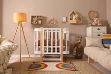 Baby Room Interior With Stylish Furniture And Comfortable Crib