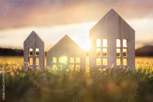 Fotografie, Tablou Ecological wood  model house in empty field at sunset
