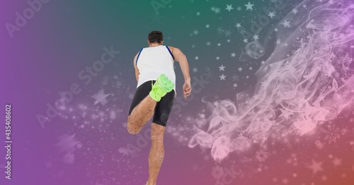 Composition of rear view of fit male athlete running with light trails on purple background