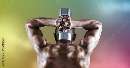 Composition of rear view of muscular strong african american man lifting dumbbells