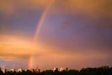 Fototapeta Rainbow - Tęcza na niebie po deszczu. Widok nieba nad miastem