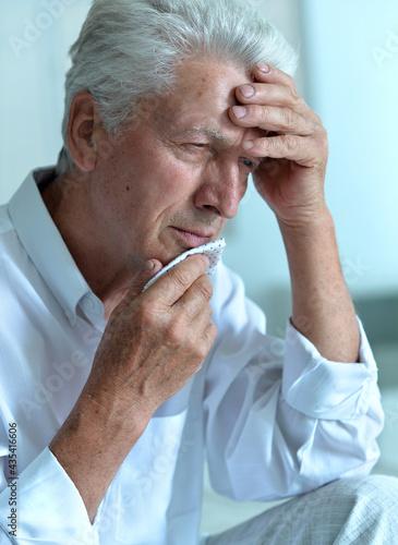 Portrait of sad sick senior man with  headache Fototapet