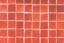 Close-up Of Red Tiled Wall. Texture Wallpaper Background.