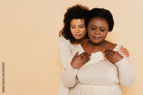 Wallpaper Mural african american middle aged mother and adult daughter hugging and holding hands
