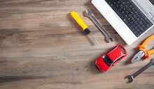 Toy Car, Wrench, Screwdriver, Pliers And Computer Keyboard.