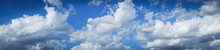 Blue Sky Background With Tiny Clouds. Panorama, Background With Clouds On Blue Sky.