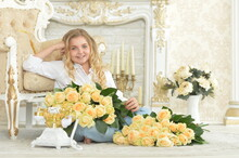Cute Curly Teen Girl Posing With Bouquet Of Yellow Roses