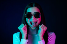 Photo Of Impressed Young Millennial Lady Hands Fists Wear Eyewear White Sweater Isolated On Black Dark Color Background