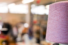 Large Reel Of Natural Pink Cashmere Yarn In A Factory