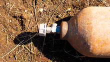 A Close Up Image Of An Old Rusted Propane Cylinder Shut Off Valve.