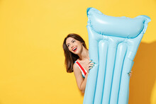 Happy Young Sexy Woman Slim Body Wear Striped Red Blue One-piece Swimsuit Hold Pose Inflatable Mattress Isolated On Vivid Yellow Color Background Studio Summer Hotel Pool Sea Rest Sun Tan Concept