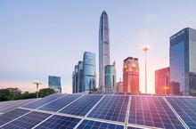 Ecological Energy Renewable Solar Panel Plant With Urban Landscape Landmarks In Sunrise