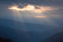 Sunlight Peeking Through The Clouds