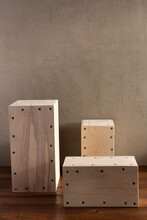 Wooden Cube Or Plywood Box Block Near Wall Background Texture. Abstract Construction Concept