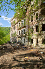 Abandoned House Destroyed By War. Mining Ghost-town Akarmara, Post-apocalyptic Concept. Remnant Of The Georgian-Abkhazian War