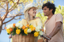 Loving Couple On Summers Day By A Bicycle With Flowers