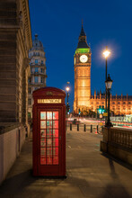 Red Telephone Box In Front Of Big Ben At Night, London, United Kingdom
