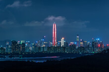 Skyline Of Downtown District Of Shenzhen City, China At Night. Viewed From Hong Kong Border