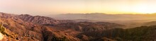 Paorama Shot Of Bare Desert Hills And Valley In Joshua Tree National Park At Last Rays Of Sunset In America