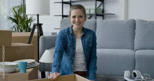 Fototapeta Cheerful woman posing in her new home
