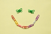 Smiley From Multicolored Paper Clips On An Isolated Background