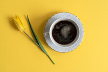 Yellow Tulips On A Yellow Background, Top View, Spring Time. A Cup Of Coffee.Copy Space, Postcard, Cosmetics, Nature, Macro, Beauty, Naturalness, Romance, Banner.